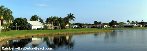 Enjoy the south Florida lifestyle as you look out across the lake at sunset from your patio in Rainberry Bay.
